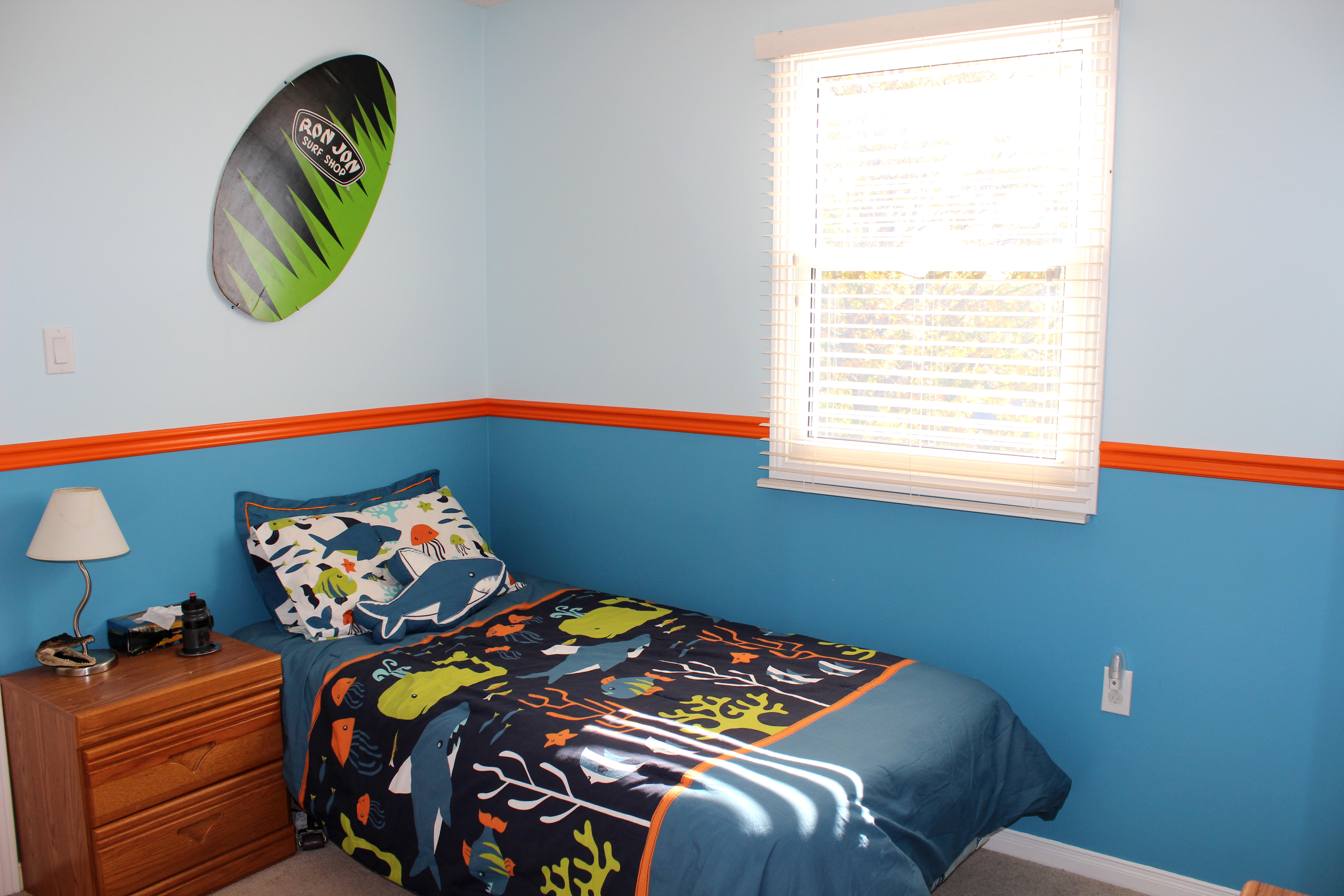 think our lil surfer dude gives his surf bedroom two thumbs up