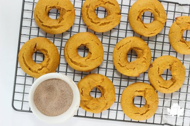 pumpkin donuts on rack with sugar